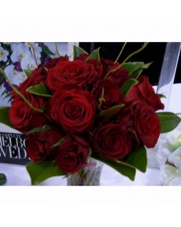 fresh red rose posy with willows and magnolia leafs this posy comes with 20 roses